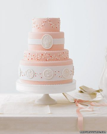 Wedding Cake with Molded Medallions The delicate gum-paste flowers and royal-icing beading on this elegant cake evoke classic white-on-white embroidery. The ornate three-letter monogram was copied from the hemstitched runner.
