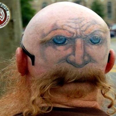 Really weird tattoo at an really odd place :D  Weird world