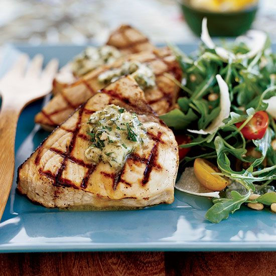 Basil-caper butter elevates this recipe for grilled swordfish from barbecue expert Steve Raichlen. The intense flavors melt into the meaty swordfish steaks.