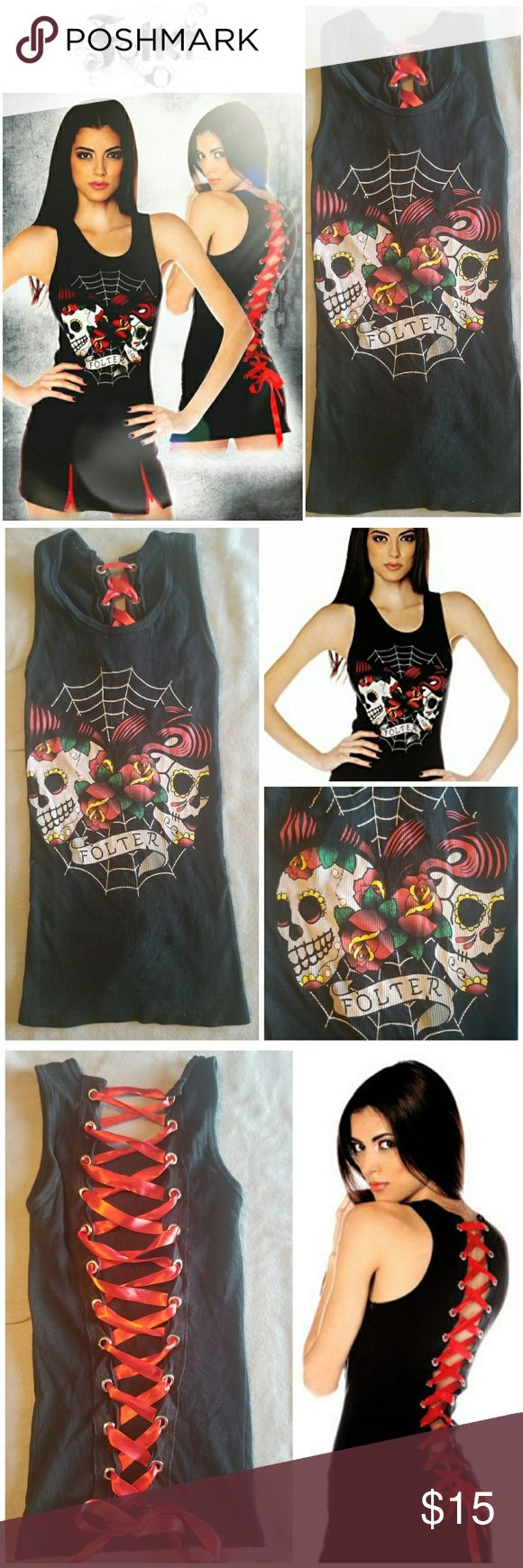 LIKE NEW Folter Corset Back Sugar Skull Tank Top Great condition, basically new size small pin-up style tank top by Folter, a Modcloth company. Runs small, so being XS would be best. Worn once then put in storage & forgotten. No rips, holes, or stains. Solid black tank with a spider web w/ 2 Dias De Los Muertos style (sugar) skulls & roses. Back looks like a corset, it has holes up both sides to weave a ribbon through. Includes original red ribbon. Bought from a small local shop, but the…