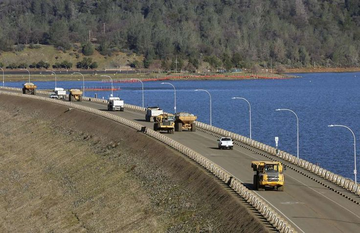 Dramatic new images show scale of damage to Oroville Dam spillway -  February 28, 2017:    Truck after truck line the Oroville Dam roadway as the effort to stabilize the emergency spillway continues on Tuesday Feb. 14, 2017, in  Oroville, Ca