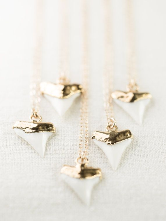 Mano-niho-kahi- (mah NO-NEE ho-KA-hee) - Shark with one tooth.    A gorgeous gold shark tooth pendant necklace. A single white shark tooth dipped