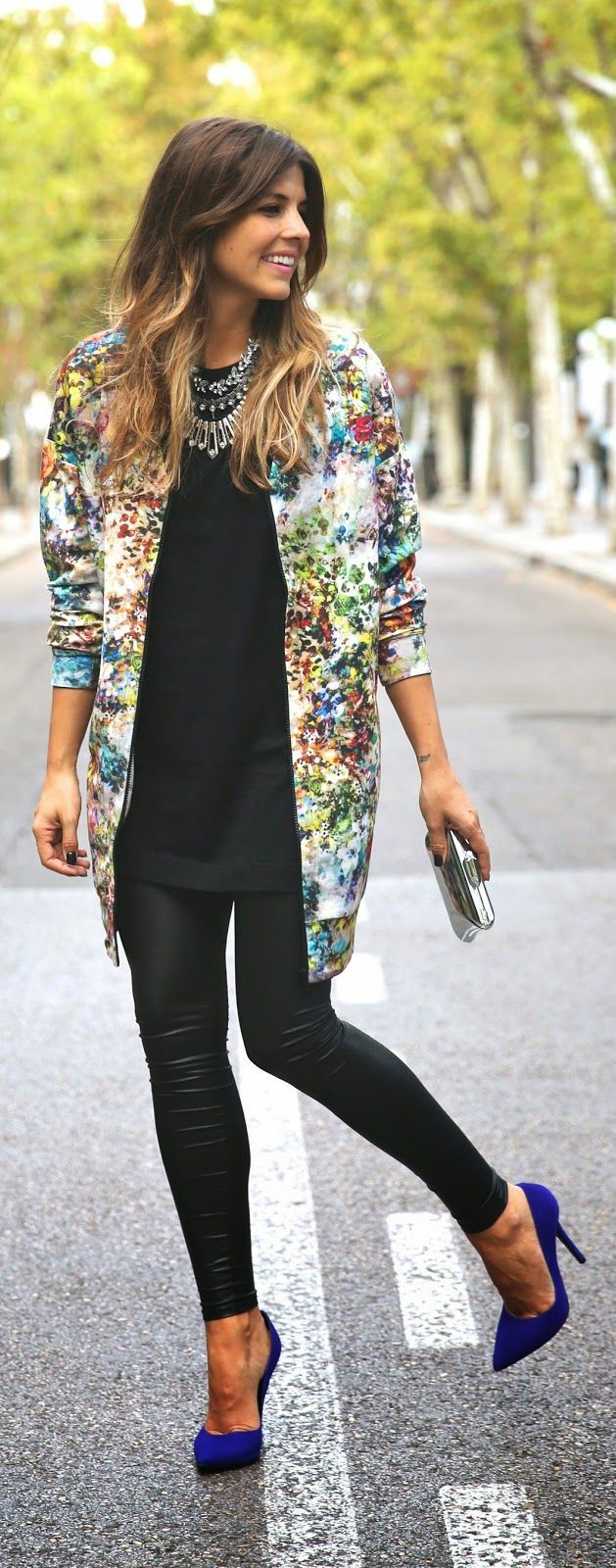 Try wearing a colorfully printed coat over an all black outfit to brighten up your outfit. Electric blue heels wouldn't hurt either! ;)