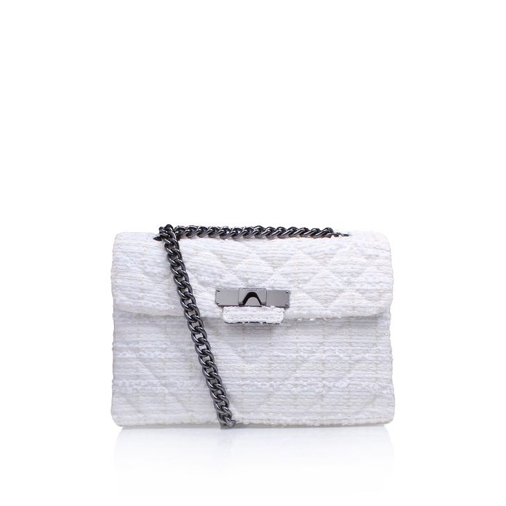 White Shoulder Bag Round off chic ensembles with the rich texture of Kurt Geiger London's latest accessory. Set in white, the thoroughly modern Tweed Kensington Bag features pops of hardware and a chain strap for swinging it over your shoulder. H 17.5cm x W 26cm x D 10cm.