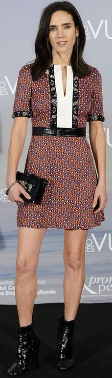 Jennifer Connelly's print dress, purse, and black patent boots style