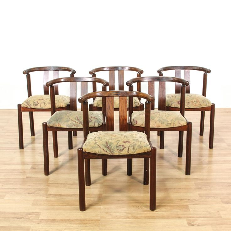 This set of 6 dining chairs is featured in a solid wood with a mahogany stain. Each Danish Modern style side chair has a barrel back, upholstered cream seat, and curved back splat. Stylish chairs that are perfect for extra seating! #danishmodern #chairs #diningchair #sandiegovintage #vintagefurniture