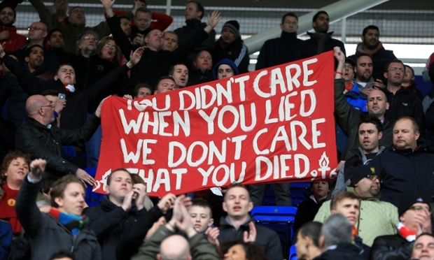 Some Liverpool fans make their feelings clear about the death of Margaret Thatcher during the Barclays Premier League match at the Madejski Stadium, Reading.