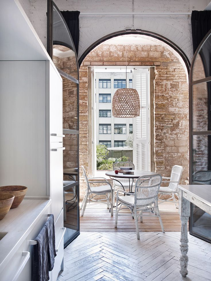 Step inside this light, open plan apartment in a 19th-century mansion block in central Barcelona