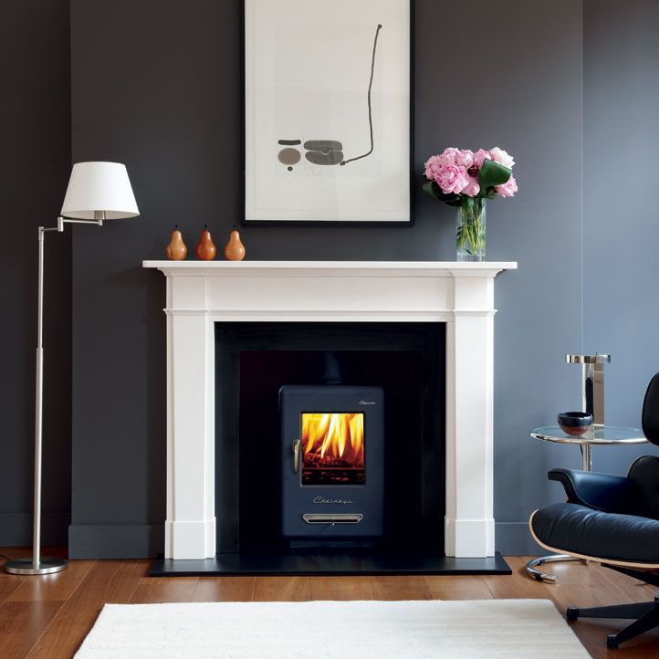 Chesneys grey and White fireplace with stove