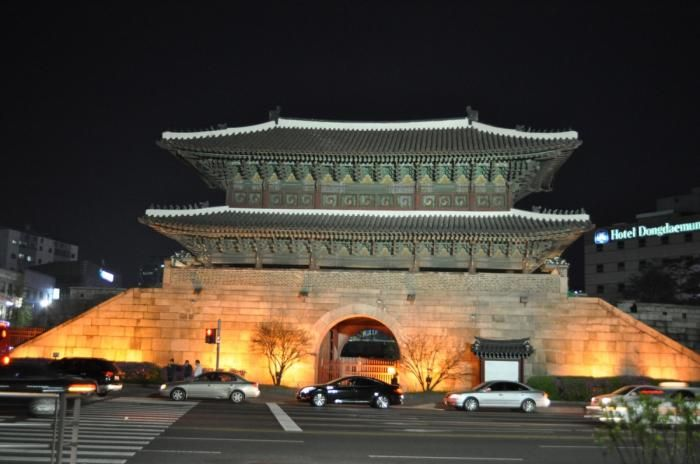 """Heunginjimun, literally """"Gate of Rising Benevolence"""" or more commonly known as Dongdaemun, is one of The Eight Gates of Seoul in the Fortress Wall of Seoul, a prominent landmark in central Seoul, South Korea."""