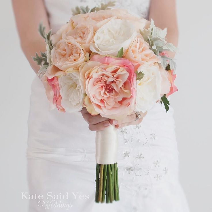 We love a good blush bouquet over here. Blush and ivory garden roses plus a dash of dusty miller are the perfect combo! Silk wedding bouquet by Kate Said Yes Weddings.