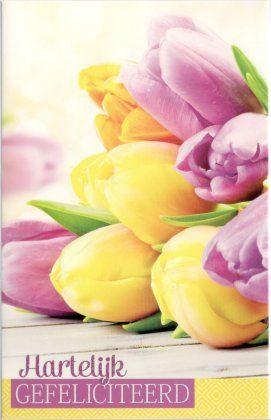 Hartelijk gefeliciteerd    Wenskaart voor vrouwe met kleurrijke tulpen.
