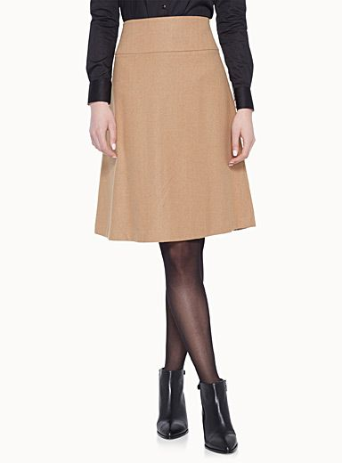 Exclusively from Contemporaine     The perfect skirt to face cool days with style   Flared fit with an ultra feminine retro flair   Hidden zip closure on the side   Soft wool-blend knit with thin, silky lining    The model is wearing size 4