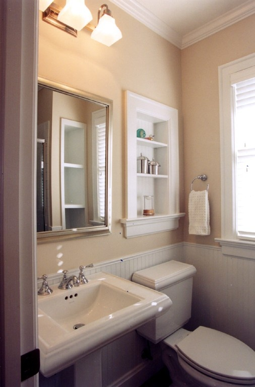 Powder Room Featuring Kohler Fixtures With Recessed