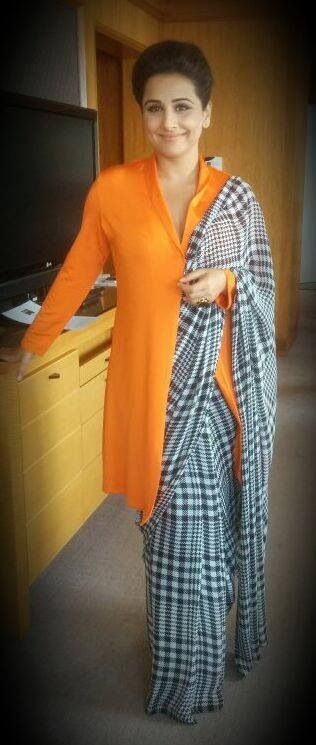Houndstooth plaid sari. With a tunic to cover older lady belly and back. I love it!