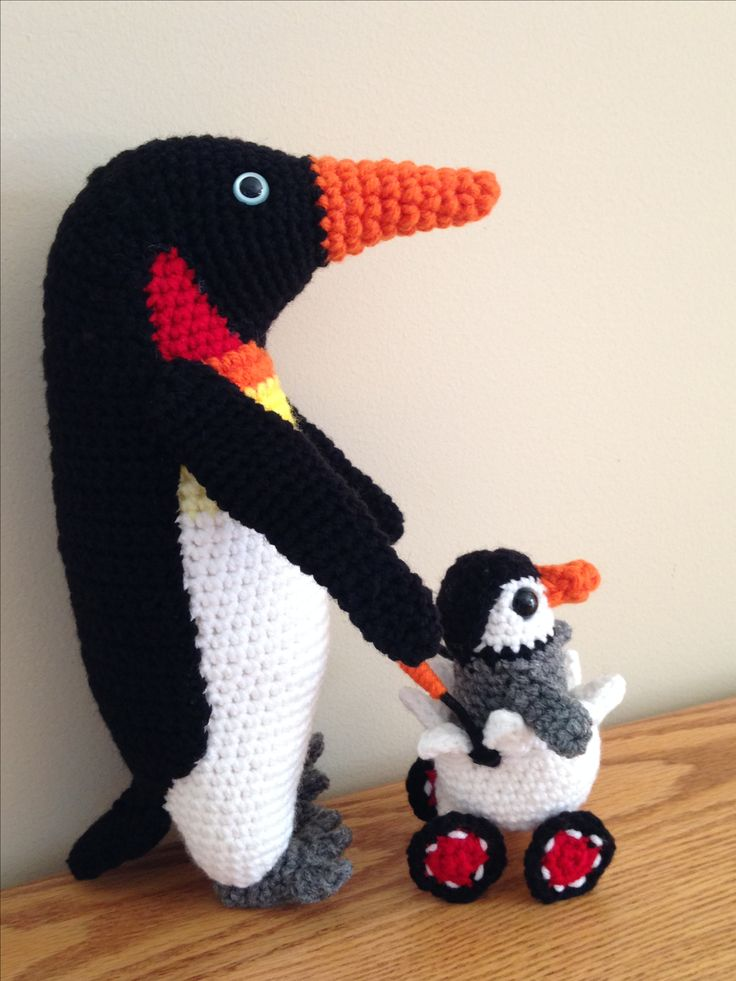 Penguin with baby and eggshell wagon