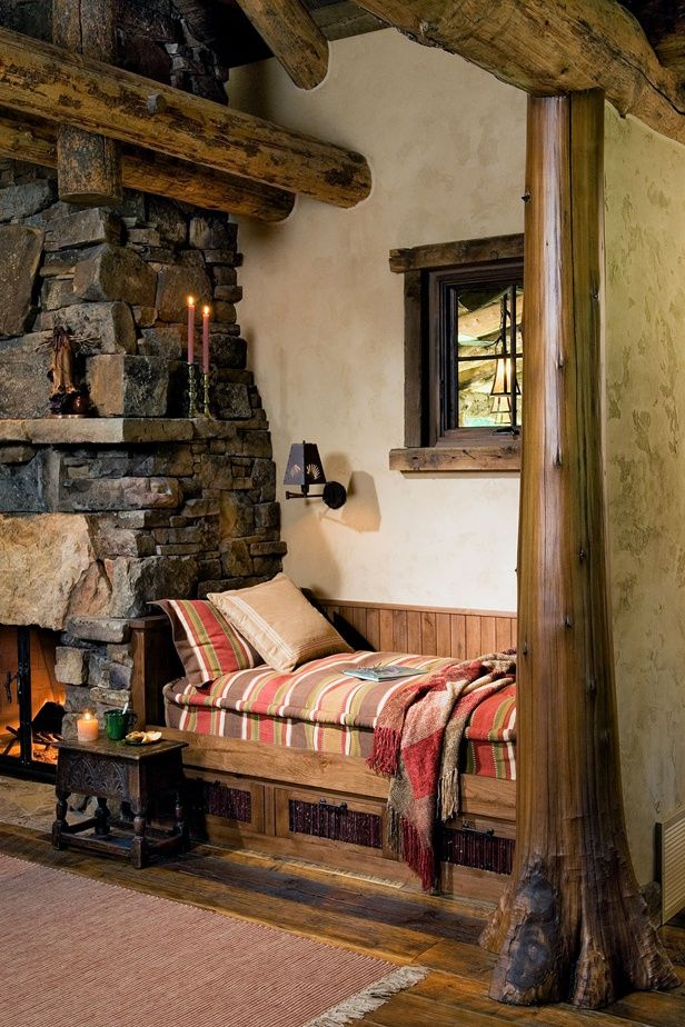 love the character in the logs along the walls and the seating area next to the fireplace. What a perfect place to catch up on your reading.