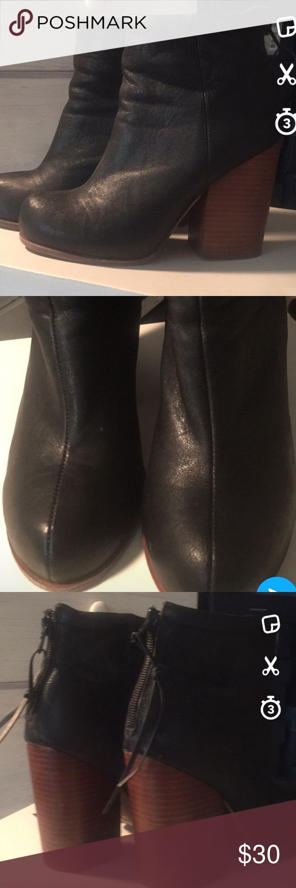 Aldo boots Black leather boots with stacked chunky heels. About 4'5 inches high. Rubber soles. Worn only 3-4 times soles are still I. Good shape.  Back zipper. Round toe with stitching down the middle the upper ankle part has  cushioned. Very comfortable and great with jeans, skirts, and dresses! Aldo Shoes Ankle Boots & Booties