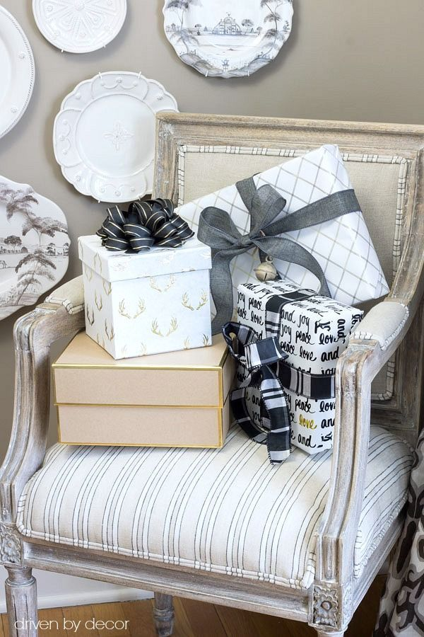 Christmas home tour - presents wrapped in black, white, and gold for Christmas