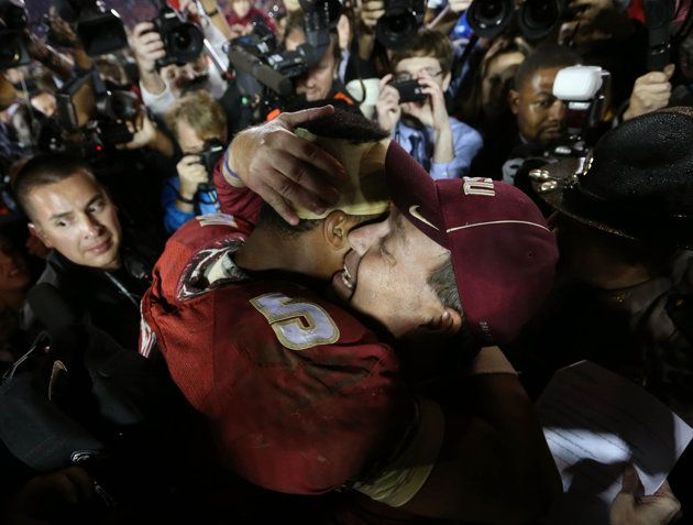 FSU quarterback Jameis Winston hugs coach Jimbo Fisher after the Seminoles' BCS title win.