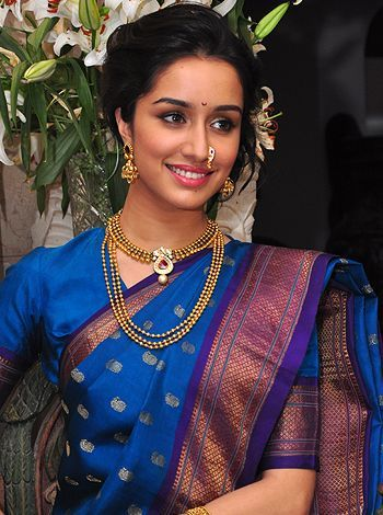 Shradha Kapoor wearing maharastrian style necklace,layered long chain and nat. Pretty blue silk saree.