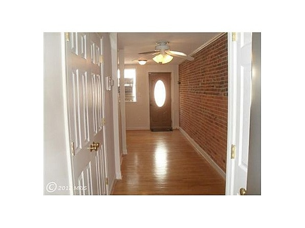 Stainless- wood floors - full sized washer/dryer- exposed brick- good sized bedroom with extra loft and dressing area-backyard- permit parking- Roof in 2010- One year AHS warranty too. easy 2 sho.If you want to live by all the action and have the convenience of walking to all that Fells Point offers.... make an appointment to see this house. Move right in and do nothing #zillow