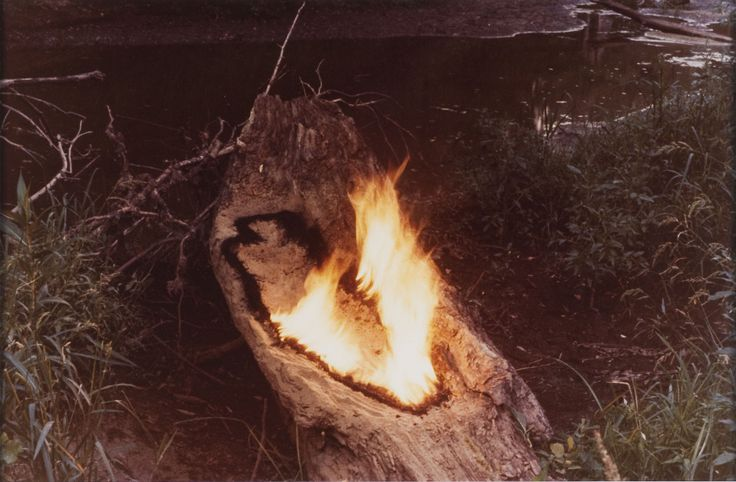 """Ana Mendieta (Cuban-American, 1948 – 1985) / """"Untitled,"""" from the """"Silueta"""" series, 1977 / Unique lifetime color photograph mounted on board documenting silueta with fire and gunpowder, Iowa / Des Moines Art Center Permanent Collections; Purchased with funds from Rose F. Rosenfield, 1997.77 / Photo Credit: Rich Sanders, Des Moines"""