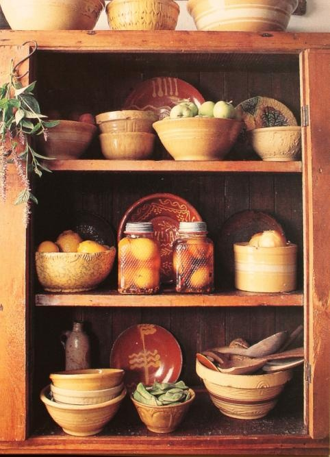 love canned good displayed with pottery and vintage kitchen items