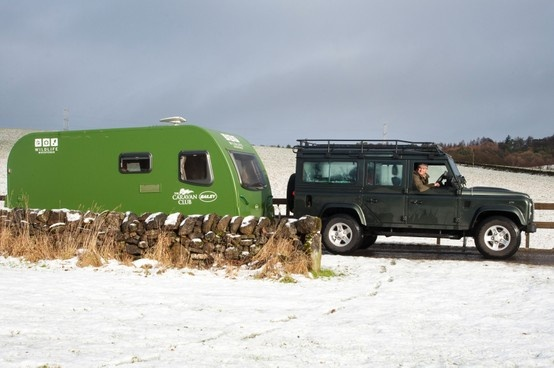 Client Caravan Club with Simon King TV Wildlife Presenter and Caravan Club Member. Pictured her with his Green Goddess, Scotland 2013.
