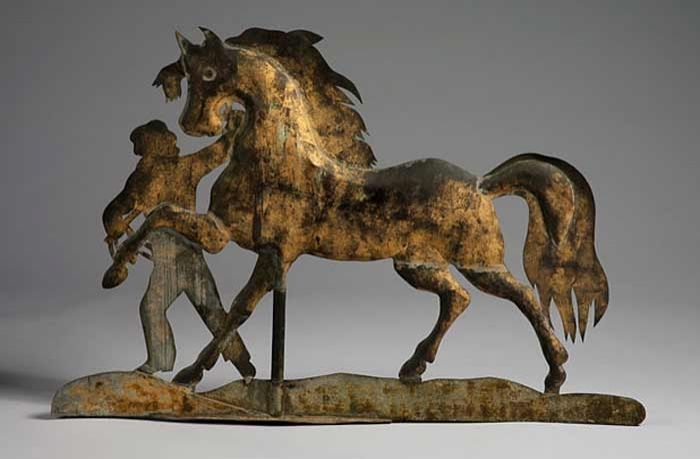 Horse and Groom weathervane - A.L. Jewell and Co., Waltham Massachusetts, C.1860 Folk Art Category: Copper with original Gilt and verdigris.Length - 24 in.  Fine example of Americana and craftsmanship is displayed in this extant example of Folk Art weathervane from the mid-19th Century.  View Other Weathervanes
