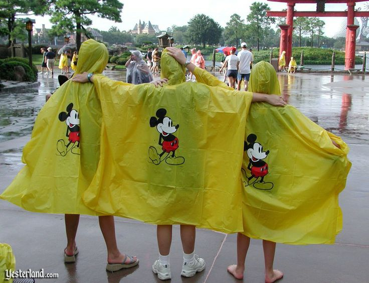 "It's hard to know when Walt Disney World began selling yellow ponchos with Mickey Mouse on the back. So let's just say, ""a long time ago.""    On September 23, 2003, WKMG, Local 6 News in Orlando, reported that Walt Disney World was switching from yellow ponchos to clear ponchos."