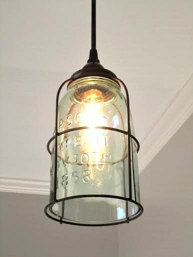 """Great Pendant light!! Do you love mason jars? Here you have a single half gallon jar with a rust """"cage"""" and the bottom cut out. The glass does have a slight green/blue tint. The rust color is achieved"""