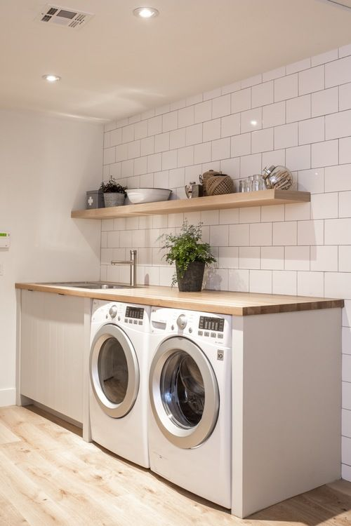 Laundry: subway tiles and wooden benchtop