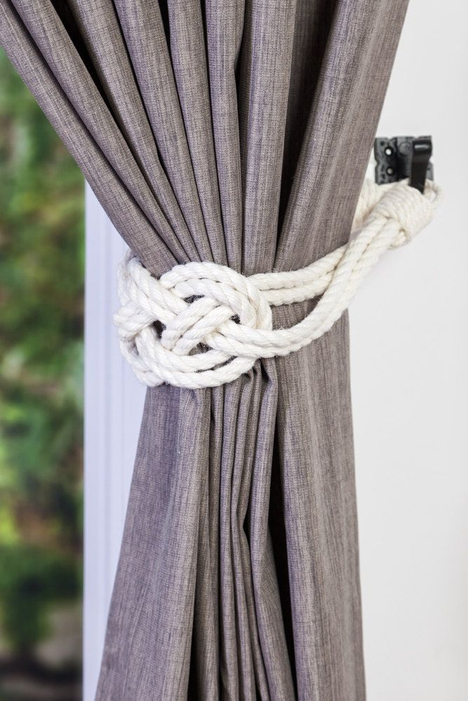 Double Carrick Bend knot Curtain tie-backs  Ivory White Cotton Rope  Carrick Bend Knot is 7 wide. Cotton rope doesnt stretch or shrink.  Suitable for indoor and outdoor use.  Tiebacks do not come with hard ware.  Other colour variations are also available : Beige and Charcoal Gray.