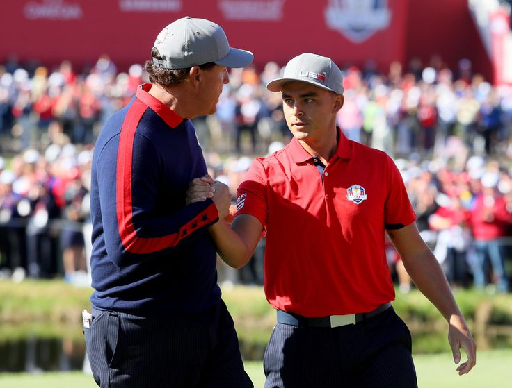 Rickie Fowler Photos Photos - Rickie Fowler and Phil Mickelson of the United States reacts after making a putt on the 16th green during morning foursome matches of the 2016 Ryder Cup at Hazeltine National Golf Club on September 30, 2016 in Chaska, Minnesota. - 2016 Ryder Cup - Morning Foursome Matches