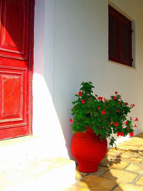 Red door and pot, Paxos island
