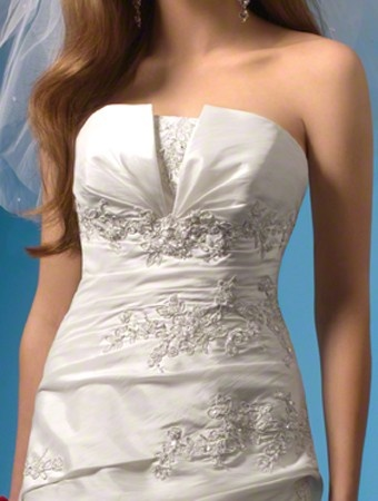 I would want a top like this in a creamy off white with a separate skirt bottom so I could throw on some jeans for the reception