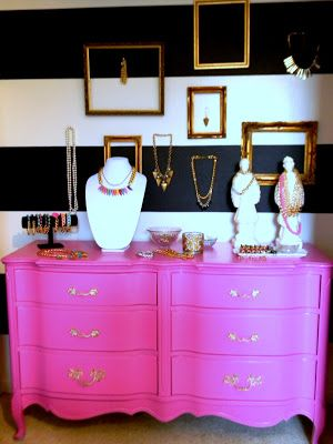 pink dresser, black and white stripes, mix matched gold baroque picture frames.
