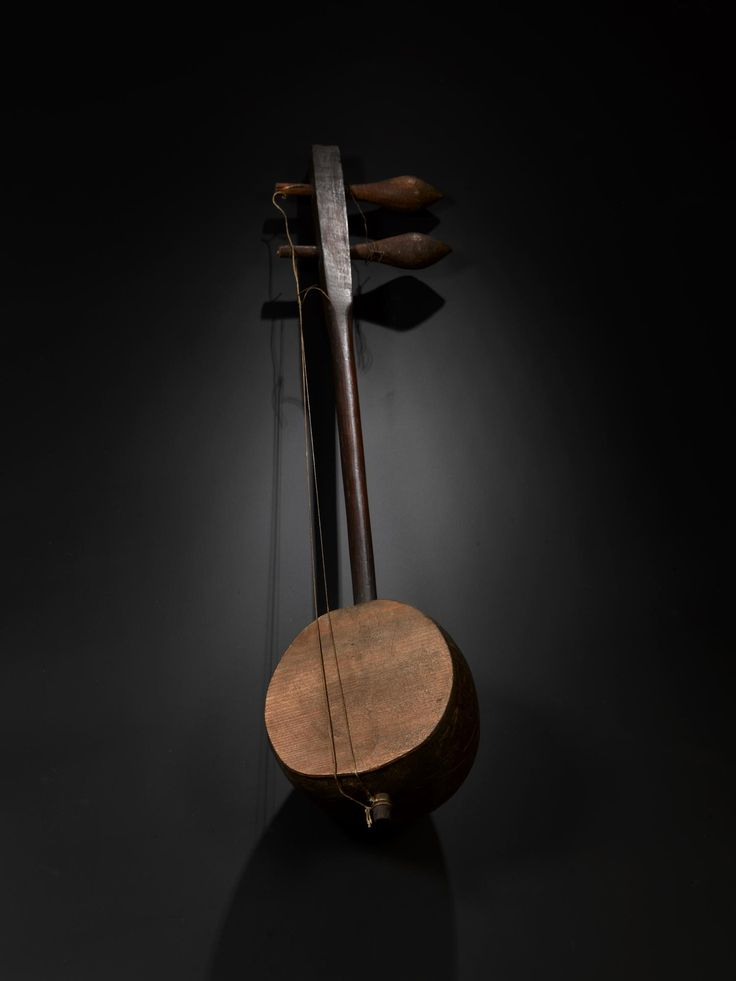 Urheen or two-stringed violin with body formed of part of a coconut, perforated with star ornament and gilt, and stem of red wood: China