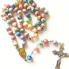 You Will Love This Beautiful Catholic Colorful Rosary. Made of High Quality Materials (Polymer Clay). Order now while in stock! Benefits of praying the Rosary: 1. It gradually gives us a perfect knowledge of Jesus Christ.2. It purifies our souls, washing away sin.3. It gives us victory over all our enemies.4. It makes it easy for us to practice virtue.5. It sets us on fire with love of Our Lord.6. It enriches us with graces and merits.7. It supplies us with what is needed to pay all our…