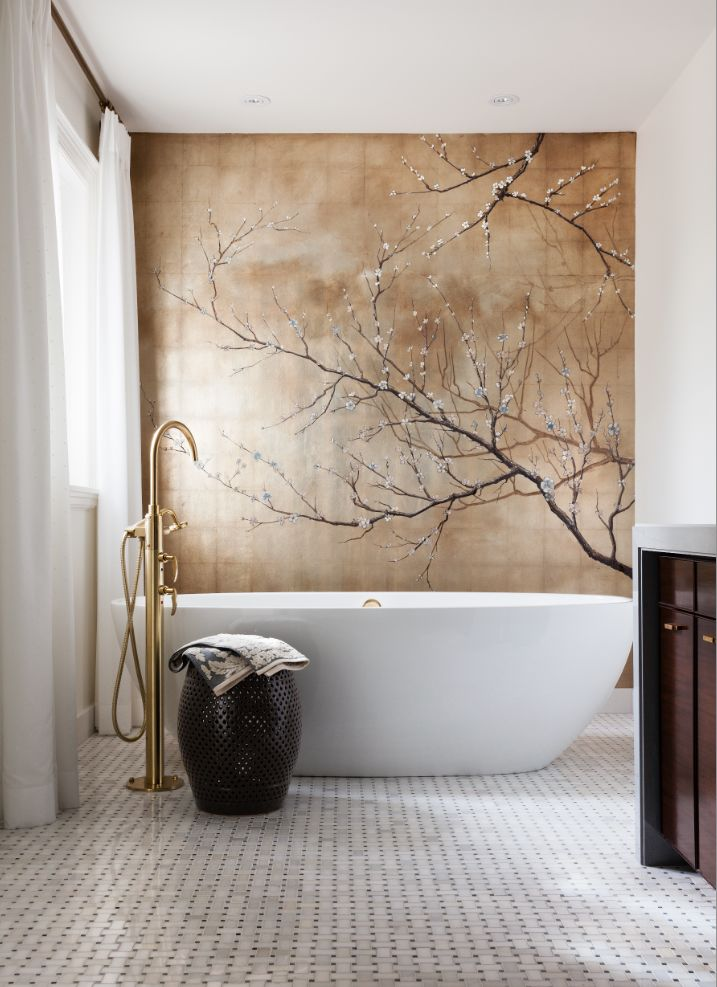 A dramatic Asian inspired mural of cherry blossoms adorns the wall behind the tub in this modern master bathroom.  By Casey Design/Planning Group www.caseydesignplan.com Photography by Ted Yarwood.