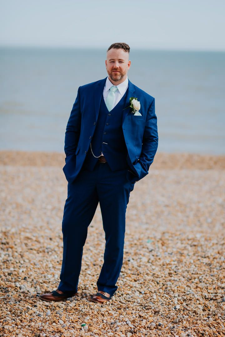 What a great looking groom - attention to detail on the suit, shoes, pocketwatch, tie, pocket square, buttonhole... the list is endless. Photo by Benjamin Stuart Photography #weddingphotography #groom #3piece #bluesuit #buttonhole #weddingsuit #weddingday #beachgroom