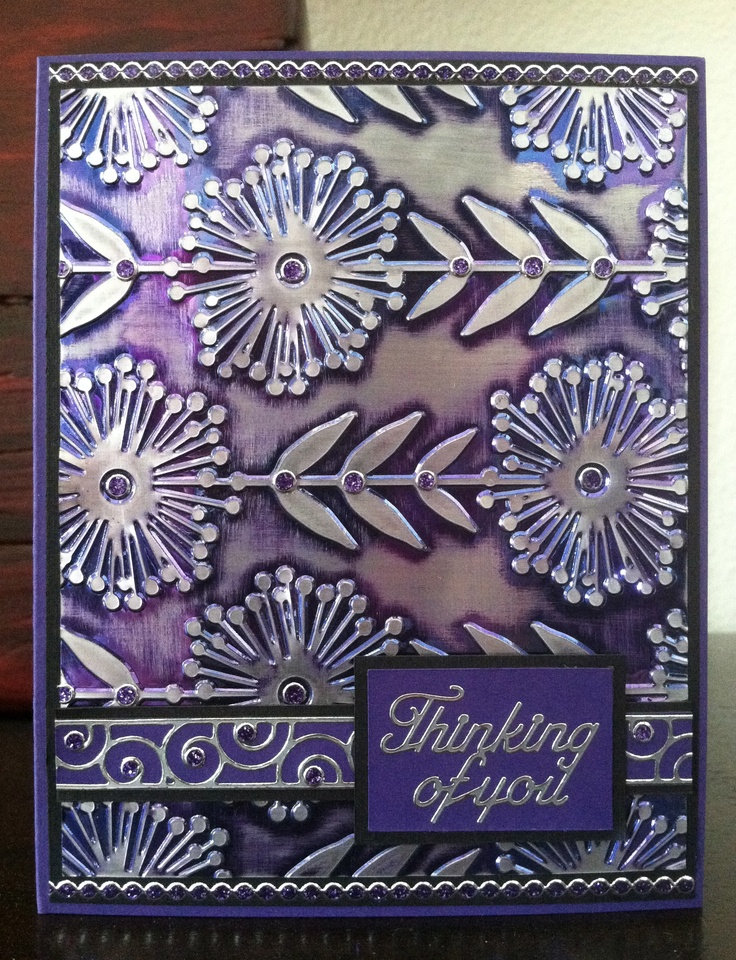 This is a quick and easy card using the Amethyst Gemstone Shimmer Sheetz. For this card I used a Sizzix embossing folder, embossed the Shimmer Sheetz and sanded it with a sanding block. The Gemstone colors have a silver core which really shows up in this card. Finished the card with a border and greeting Peel Off sticker and some glitter dots.