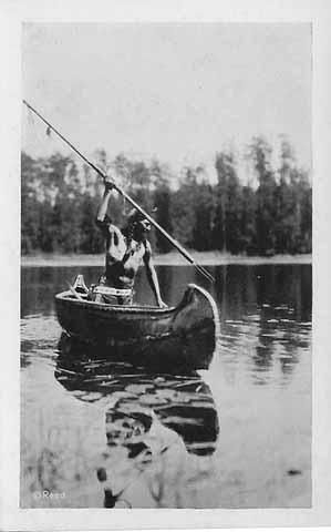 spearing fish from a canoe 1925 | The Ojibwe People's ...