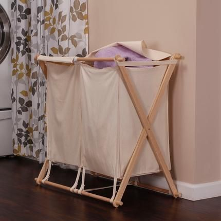"""Collapsible Wood X-Frame Double Laundry Hamper Sorter: Sort and organize your laundry with this 2 bag hamper. The raw wood frame folds down for quick out of the way storage, and can be stained to match any decor. 30""""H x 30""""W x 17""""D"""