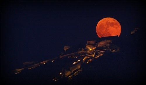 Full moon rising behind Palamidi Castle in Nafplio
