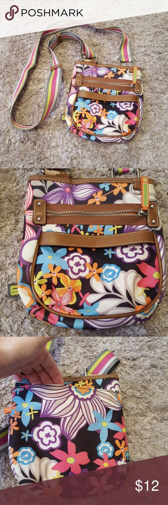 Preloved cross body Lily Bloom purse! One zipper compartment inside and one outside. Also, one open compartment on the back outside area. See pictures for approximate measurements. Preloved condition. Some wear on hardware, see picture. lily bloom Bags Crossbody Bags