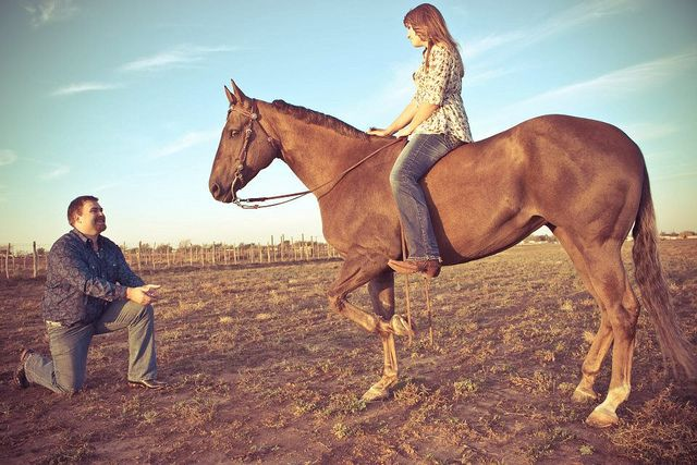 Asking her horse for permission. Photo Credit: Haley Boatright. JC Photography. Horse engagement pictures,  engagement pictures, horse pictures, couples poses, country wedding, rustic wedding.
