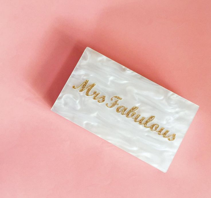 A hand-made personalised clutches label - mno logic