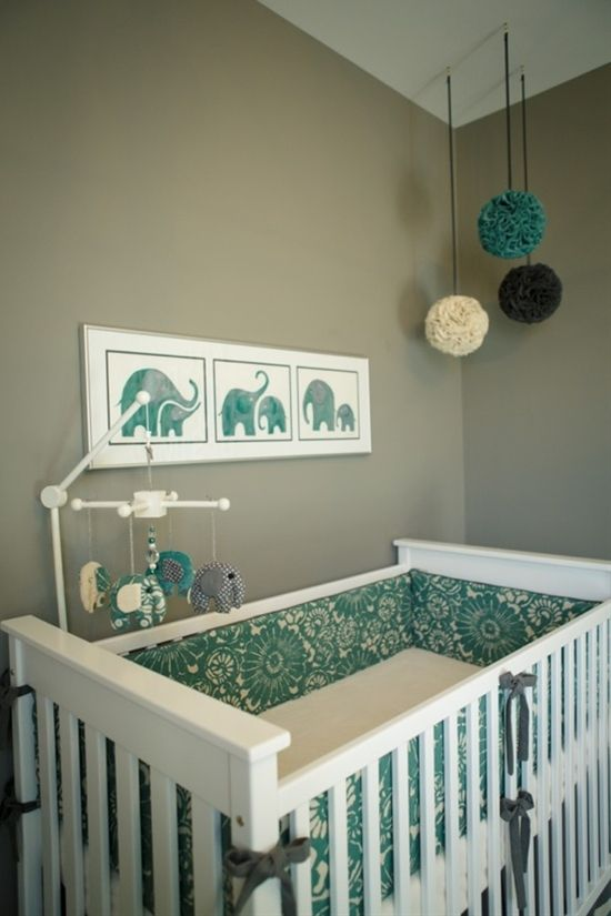 This gray nursery is super soothing with lots of turquoise and white furniture.